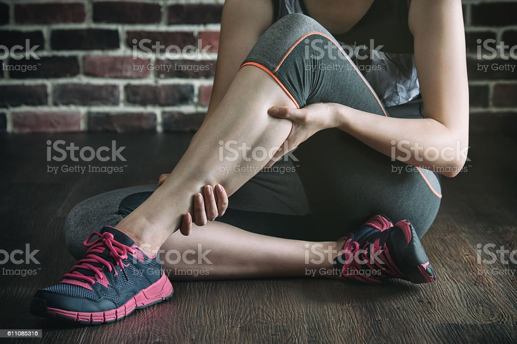 have a leg cramp in fitness exercise training, healthy lifestyle stock photo