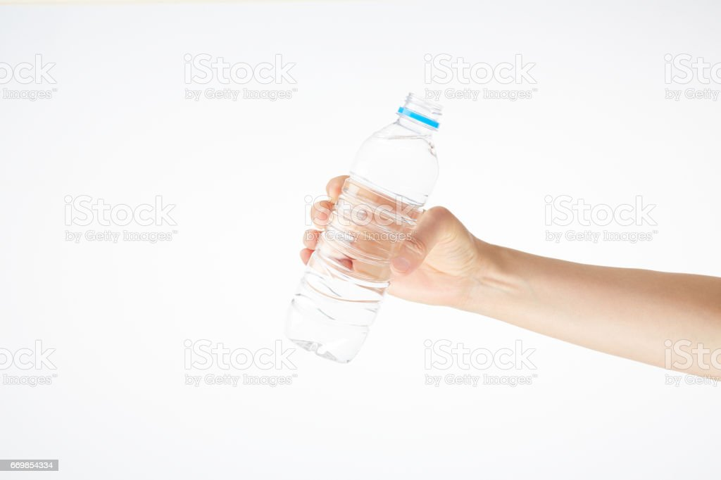 Have a plastic bottle with water in hand stock photo