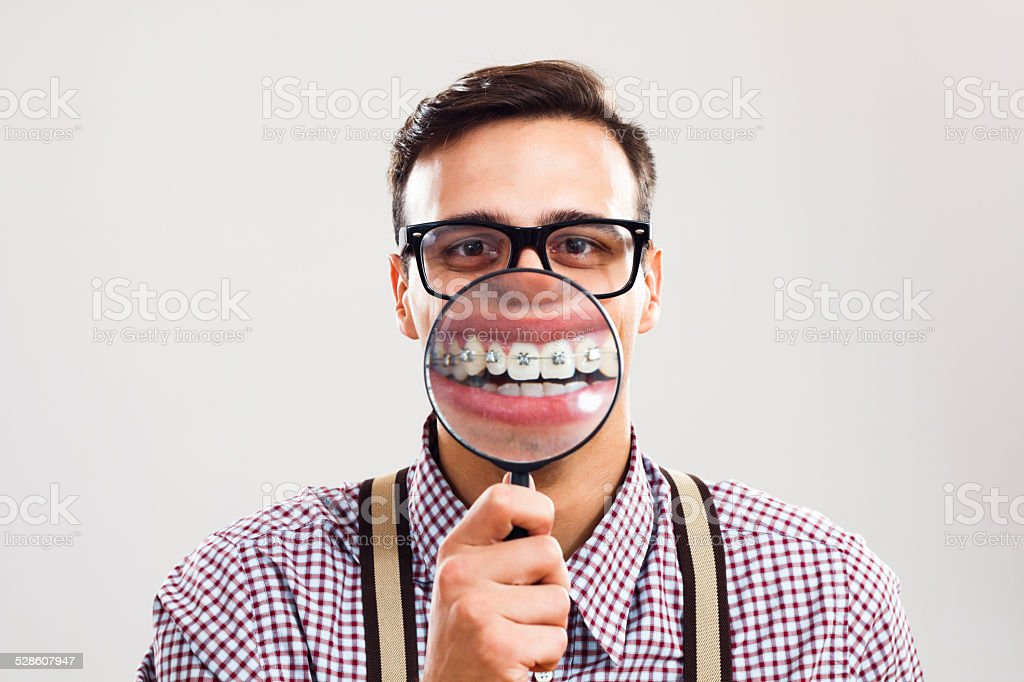 I have braces and I am still handsome! stock photo