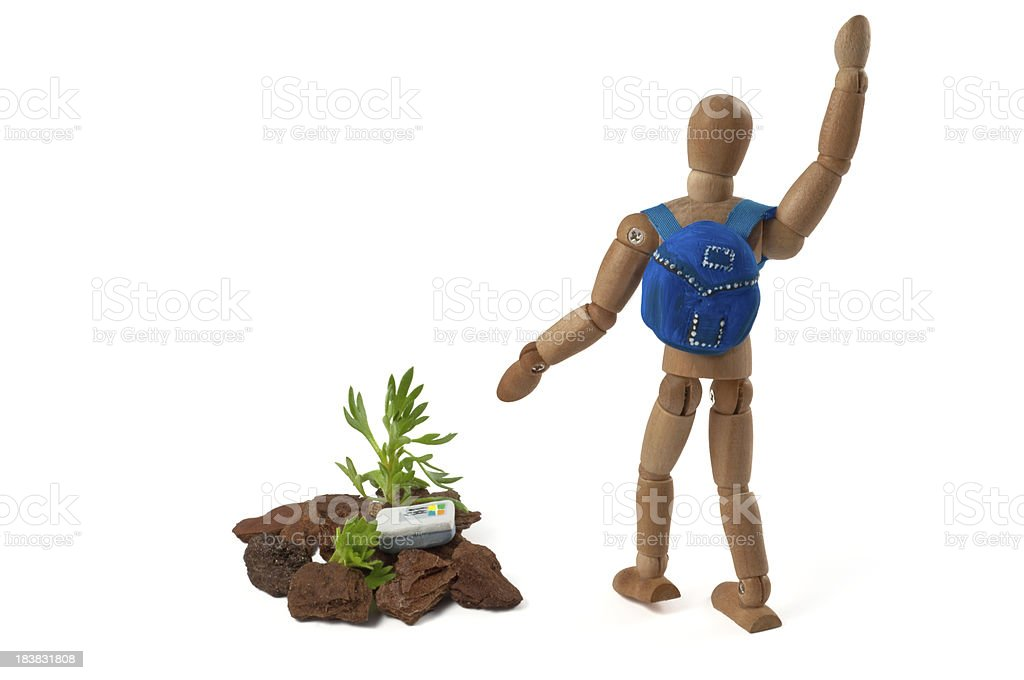 I have found him! Wooden mannequin geocaching royalty-free stock photo