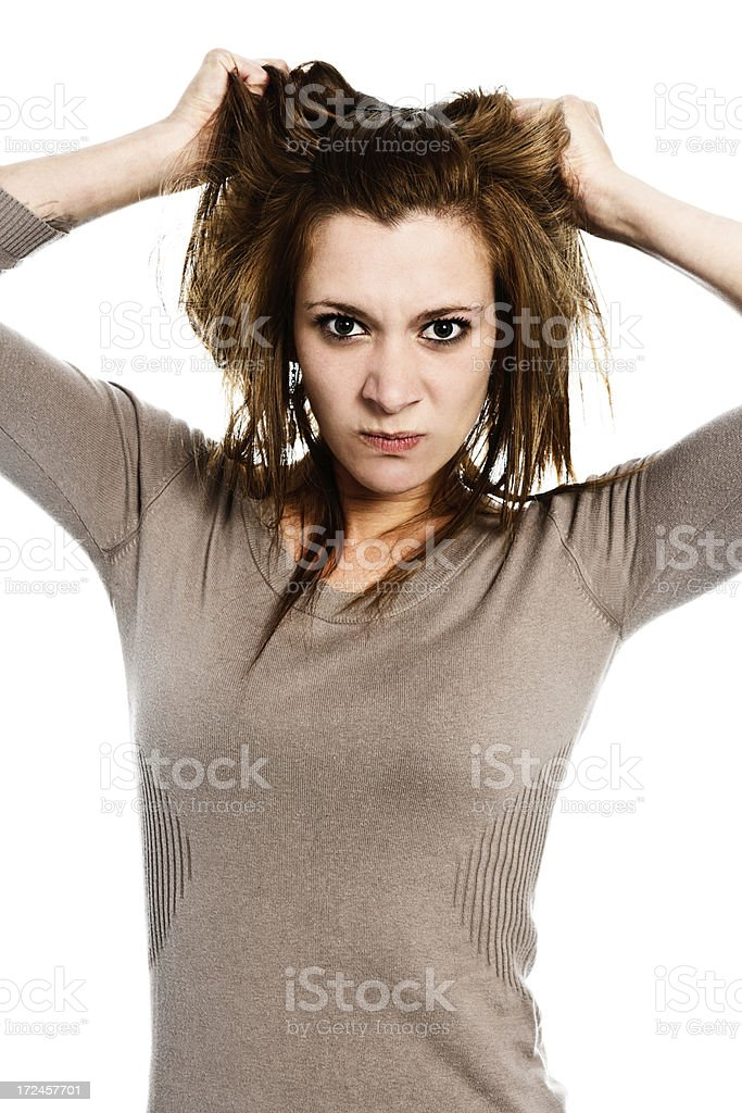 I have had enough! Beautiful brunette clutches hair and glares royalty-free stock photo