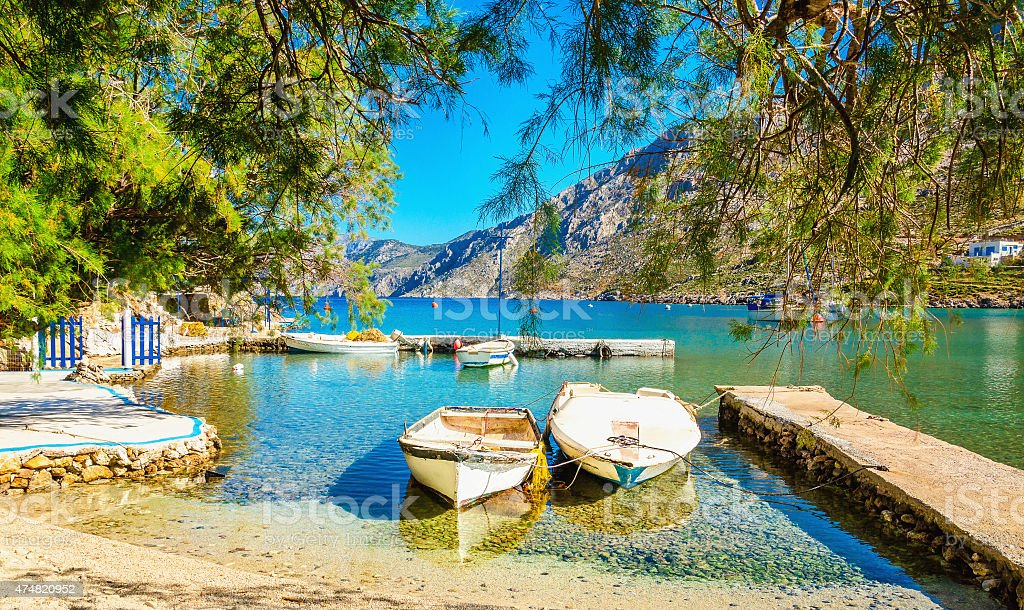 Haven with boats in sea bay , Greece stock photo