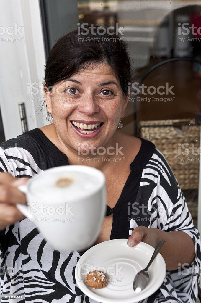 Having a capuccino royalty-free stock photo