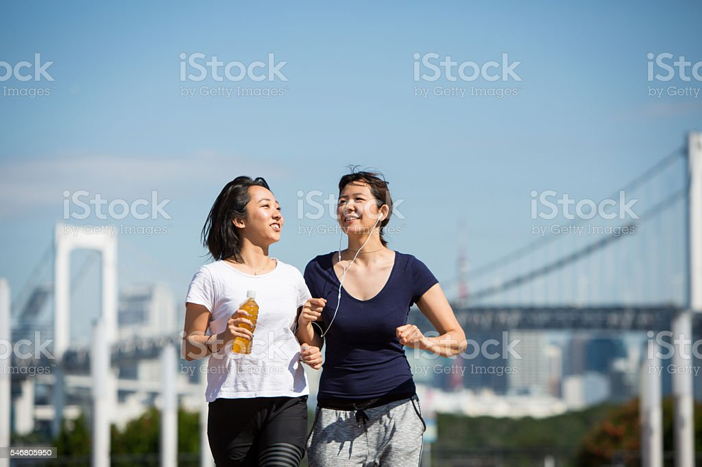 Having a chat while running together stock photo