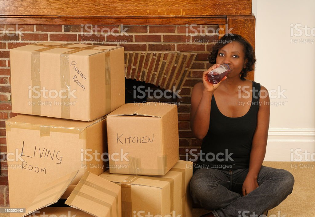 Having a Drink After Moving In to New Home royalty-free stock photo