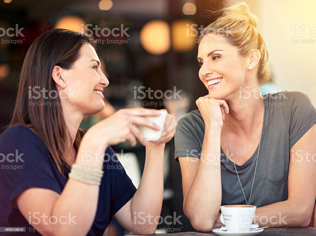 Having a heart-to-heart over coffee stock photo