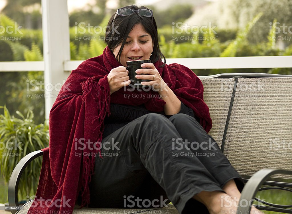 Having a hot drink in the backyard royalty-free stock photo