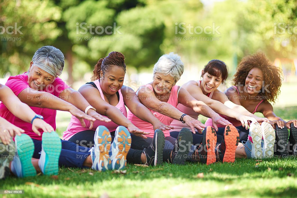 Having a laugh while limbering up stock photo