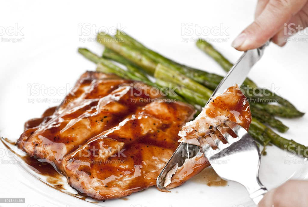 Having a piece of glazed grilled salmon royalty-free stock photo