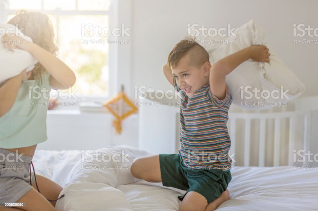 Having a pillow fight stock photo