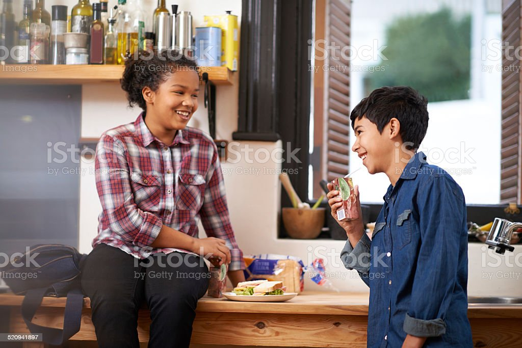 Having a tasty nibble after school stock photo