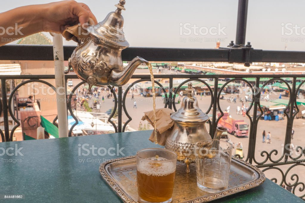 Having a traditional mint tea in Marrakesh, Morocco. stock photo