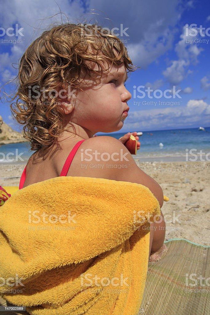 Having an apple on the beach royalty-free stock photo