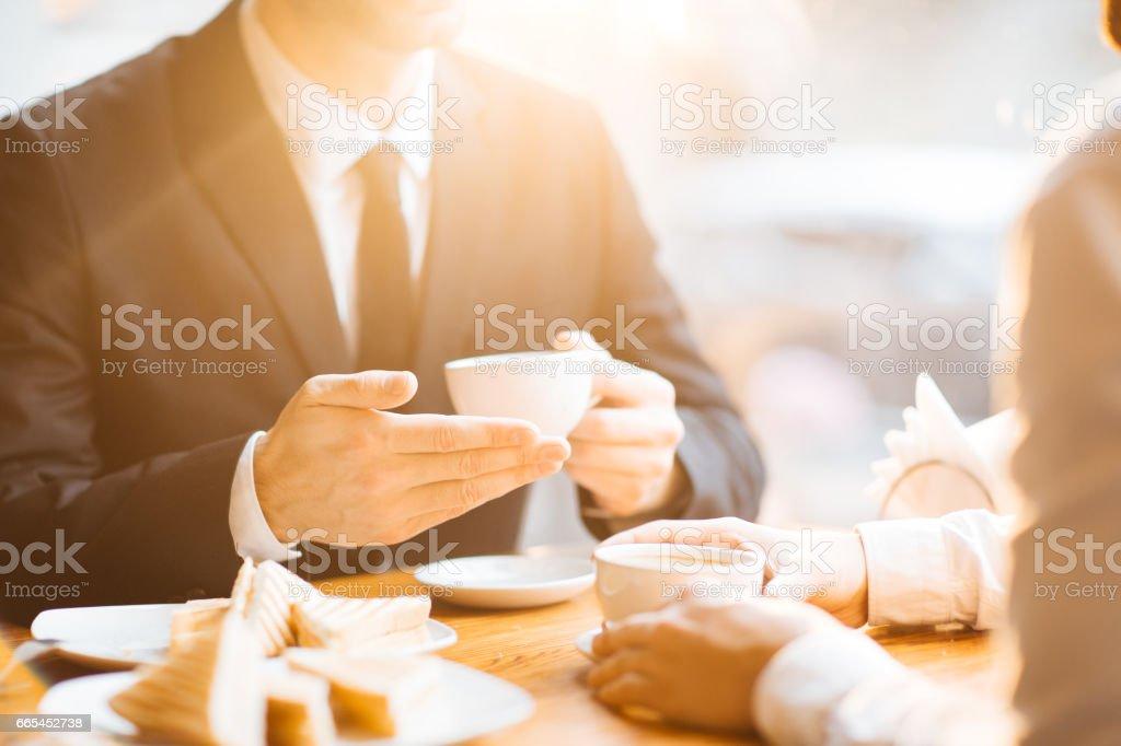 Having coffee and talk stock photo