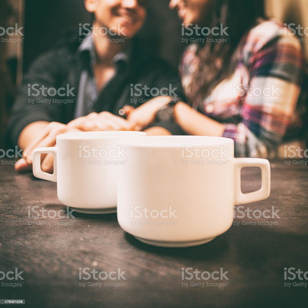 Having coffee in a cafe stock photo