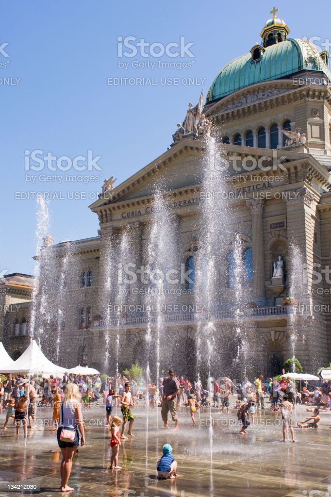 Having Fun at the fountain in front of Swiss parliament stock photo