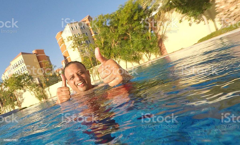 Having Fun at the Swimming Pool stock photo