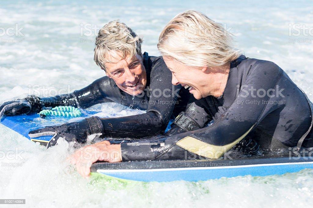 Having Fun Bodyboarding In The Ocean stock photo