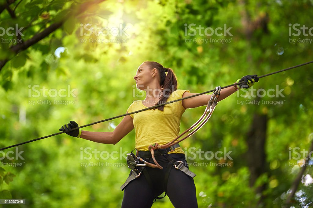 having fun in adventure park. stock photo