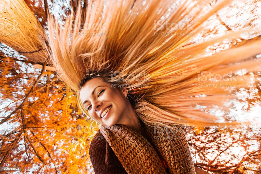 Having fun in autumn day. stock photo