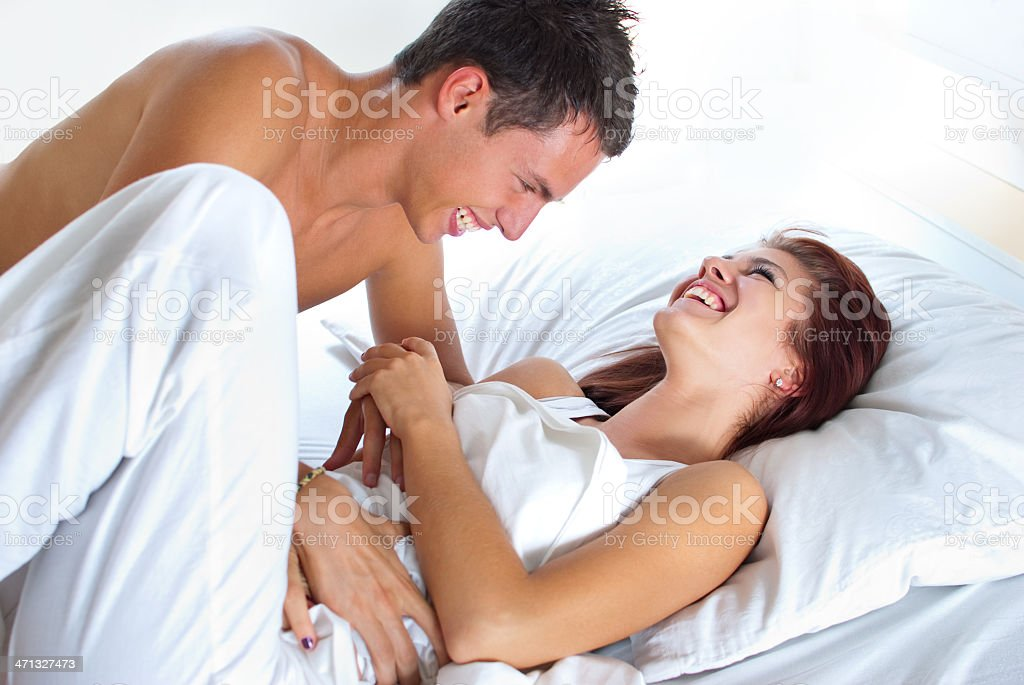 Having fun in bed. stock photo
