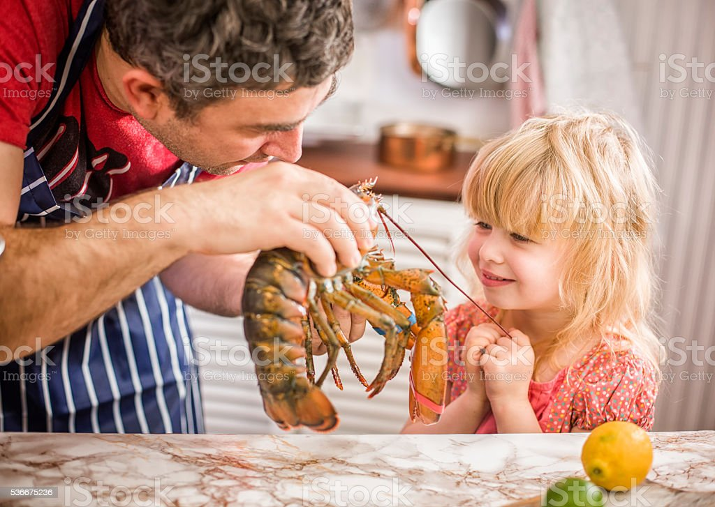 Having Fun in Preparing Fresh Healthy Lobster stock photo