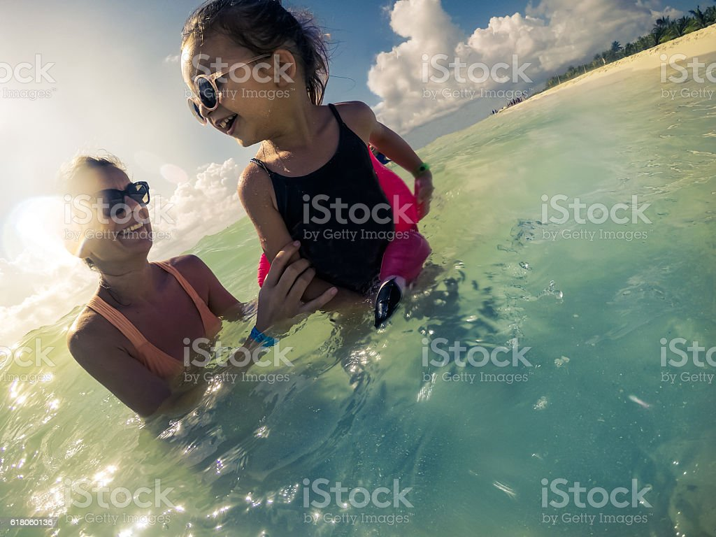 Having fun in the ocean stock photo