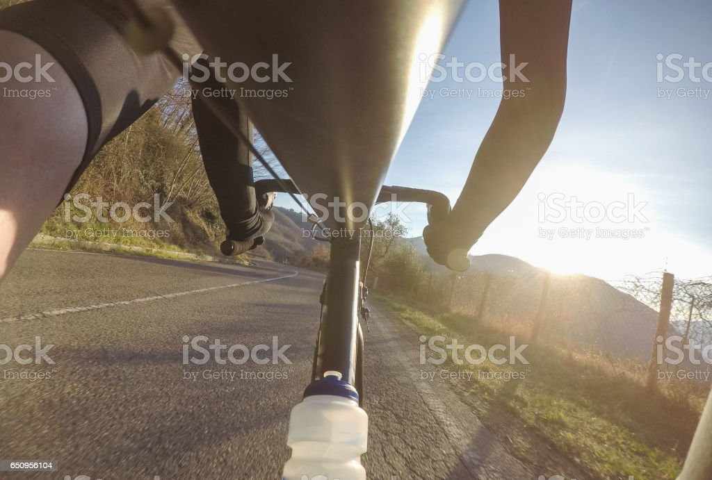 Having fun on a racing bicycle. Pov stock photo
