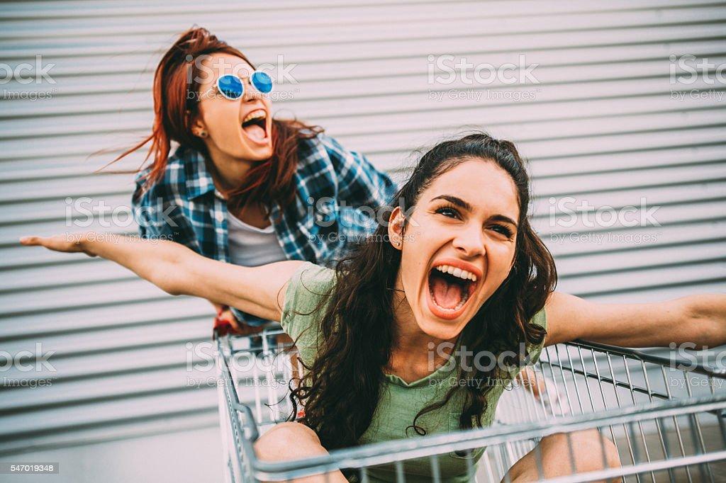Having fun on a shopping cart stock photo