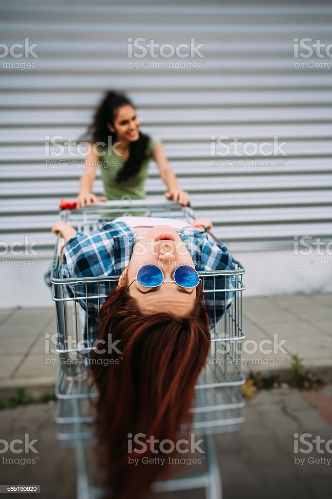 Having fun on a shopping cart stock photo