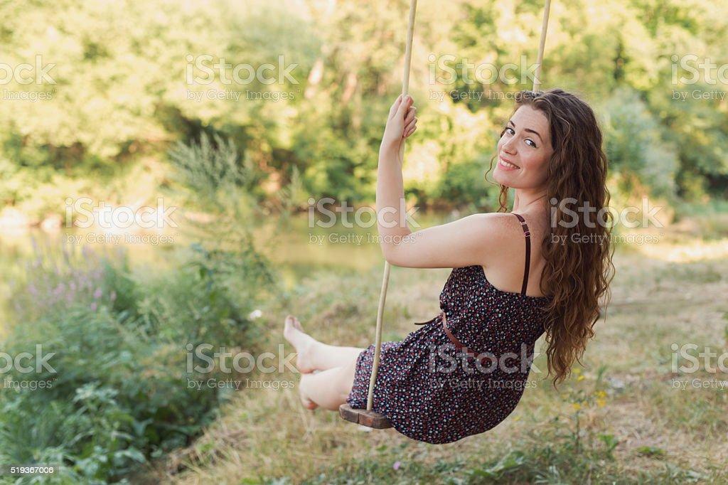Having Fun On The Swing stock photo