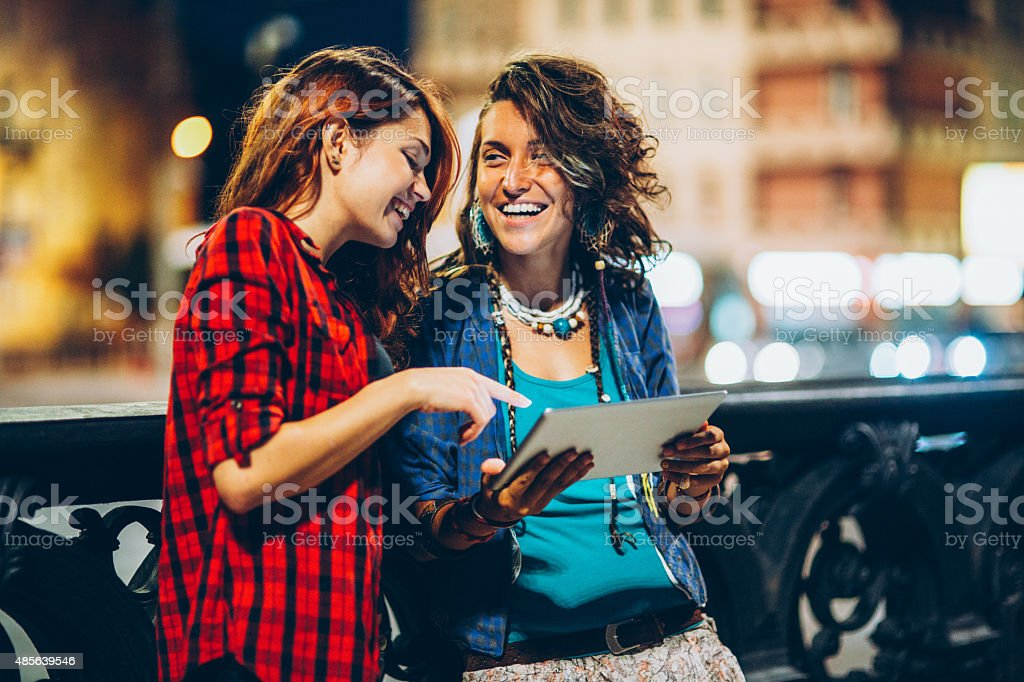 Having fun with a digital tablet stock photo