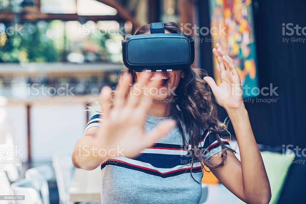 Having fun with a virtual reality headset stock photo