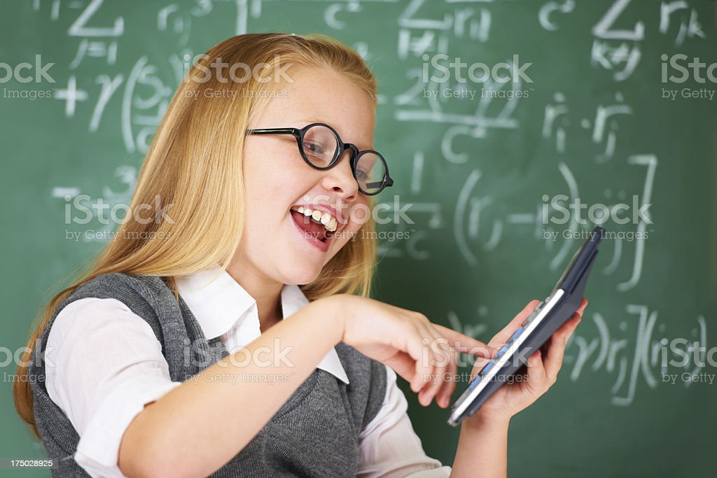 Having fun with maths on the calculator royalty-free stock photo