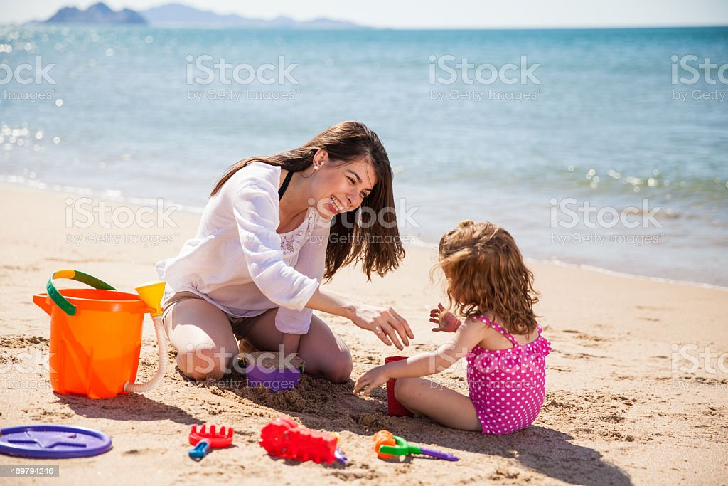 Having fun with sand stock photo
