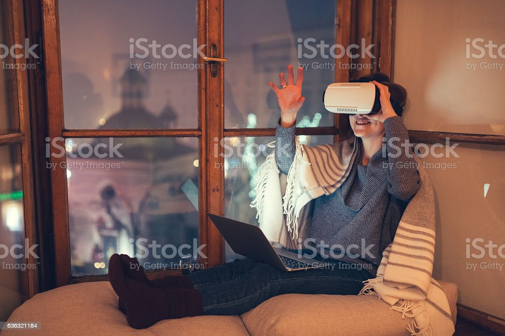 Having fun with VR simulator at home stock photo