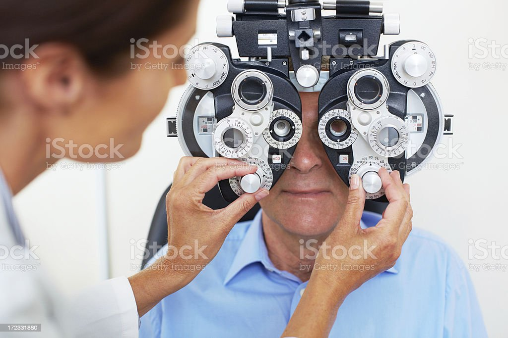 Having his yearly eye test royalty-free stock photo