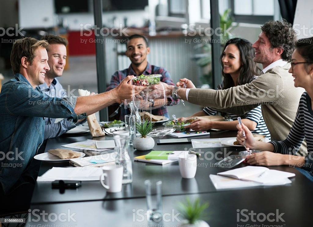 Having lunch as a team stock photo