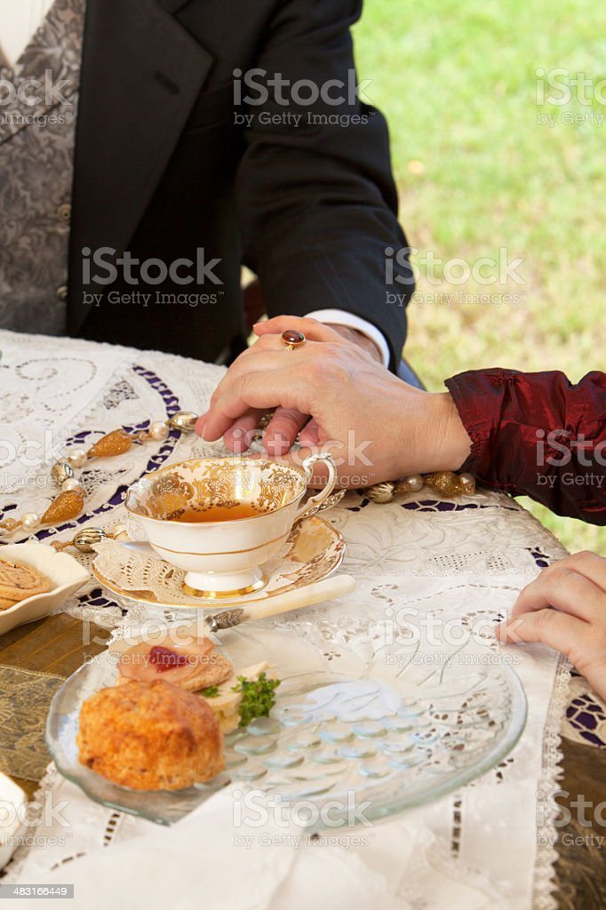 Having lunch outdoors while dressed in 1800's period costume. stock photo