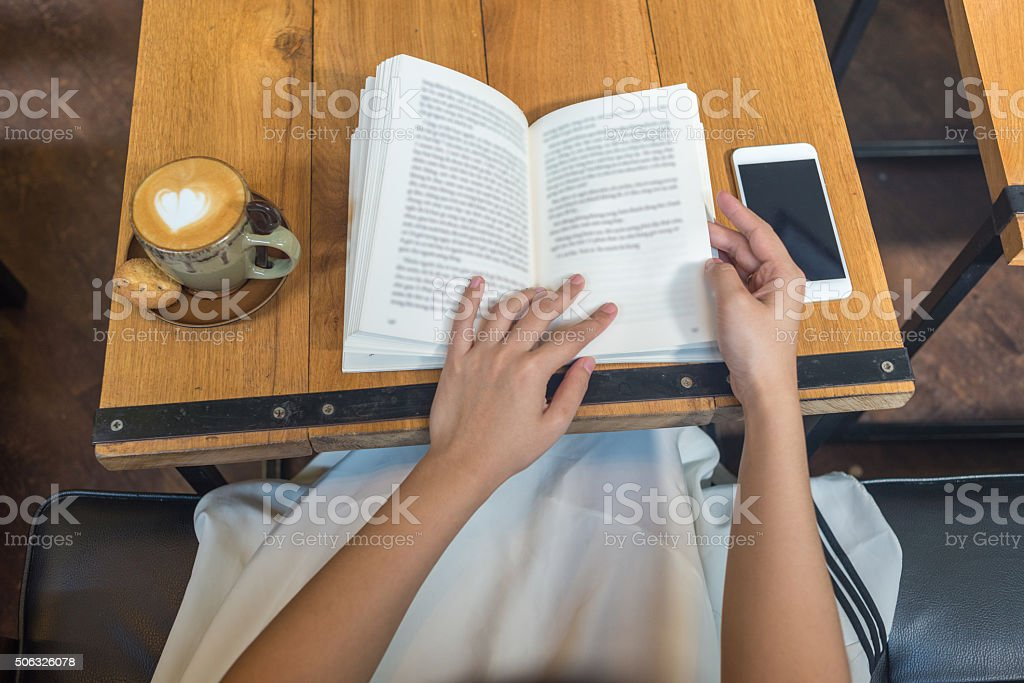 Having nice coffee and reading favorite book in beautiful morning stock photo