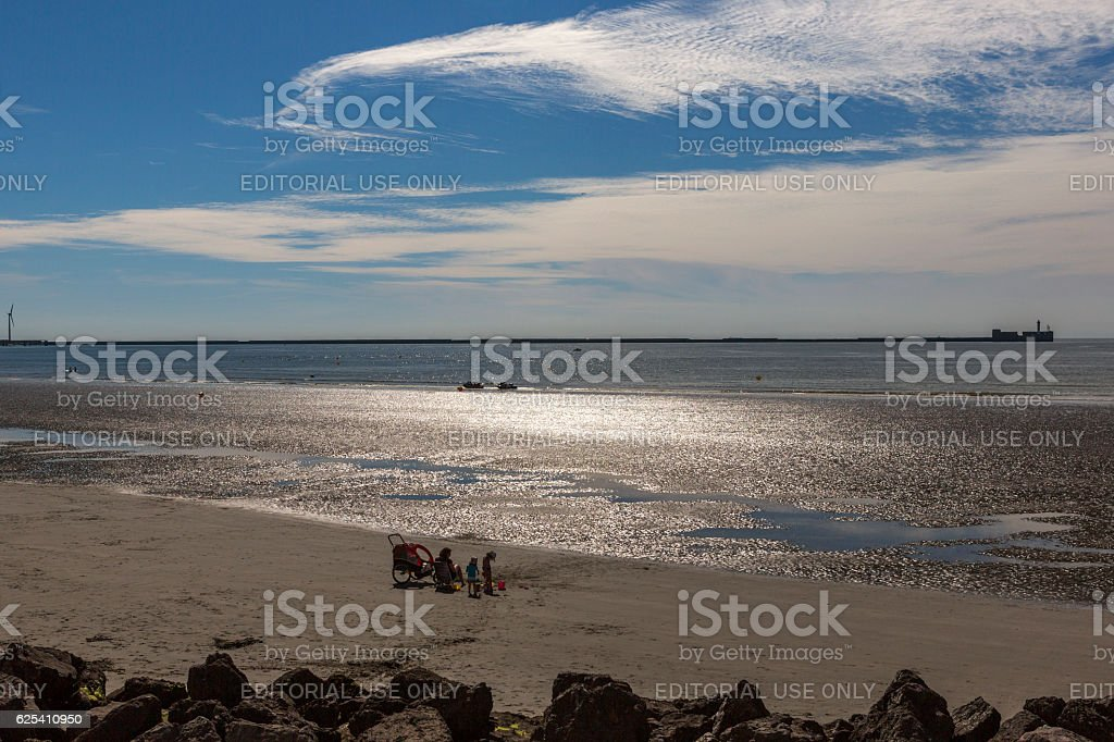 having picnic at sandy normandy during tide near calais france stock photo