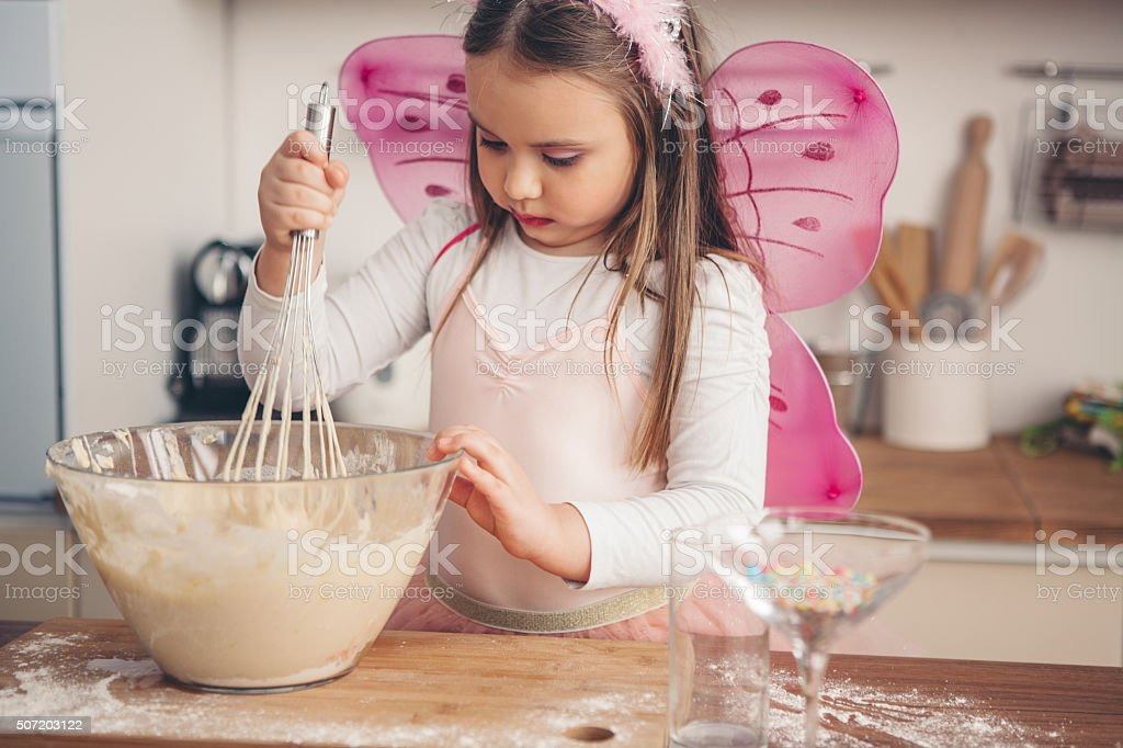 Having so much fun in the kitchen stock photo