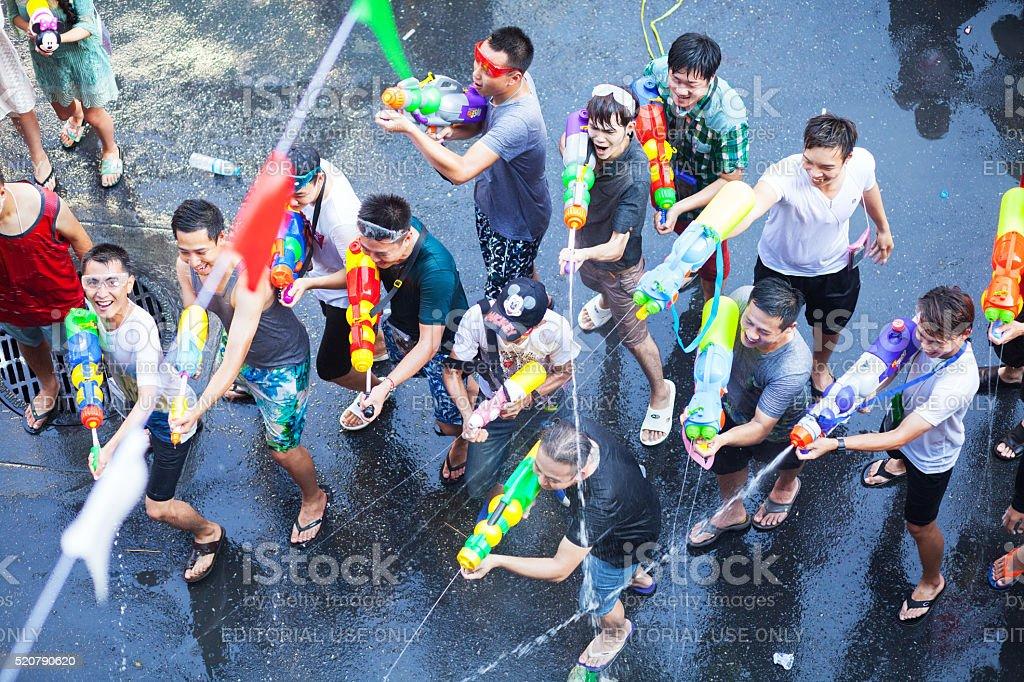 Having Songkran water fight stock photo
