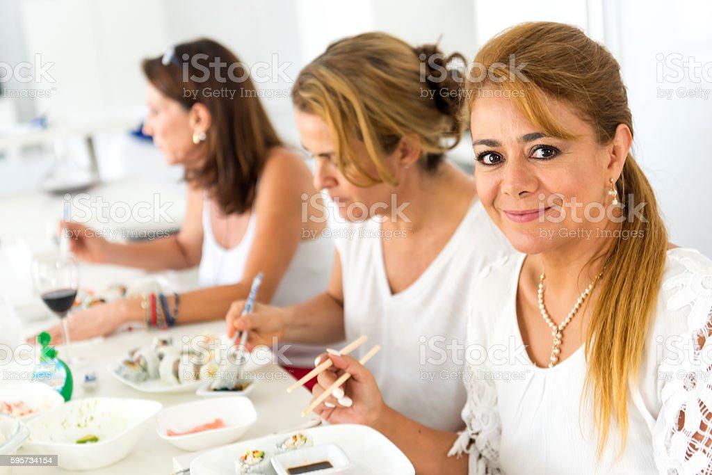 Having sushi stock photo