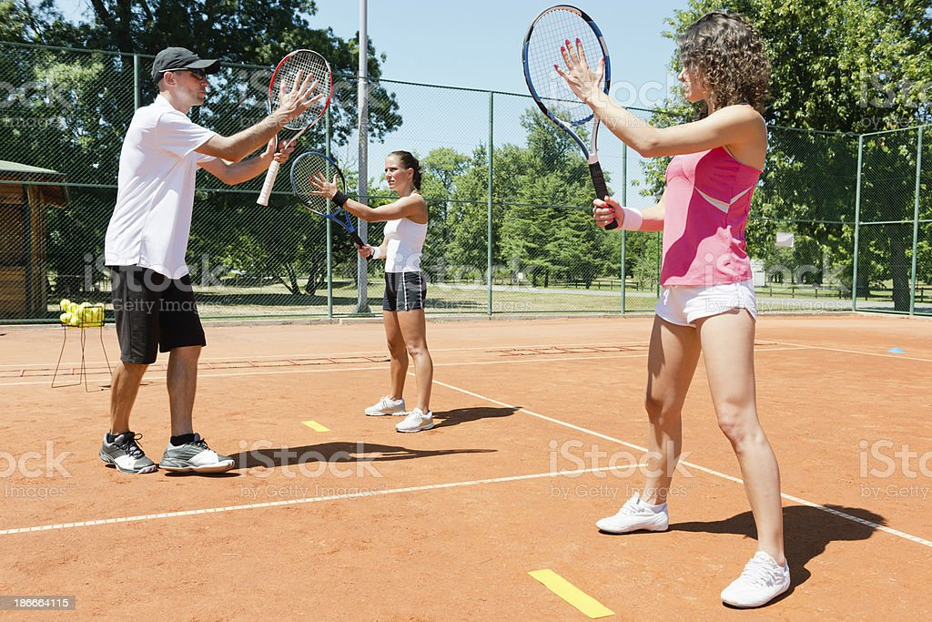 Having tennis lessons royalty-free stock photo