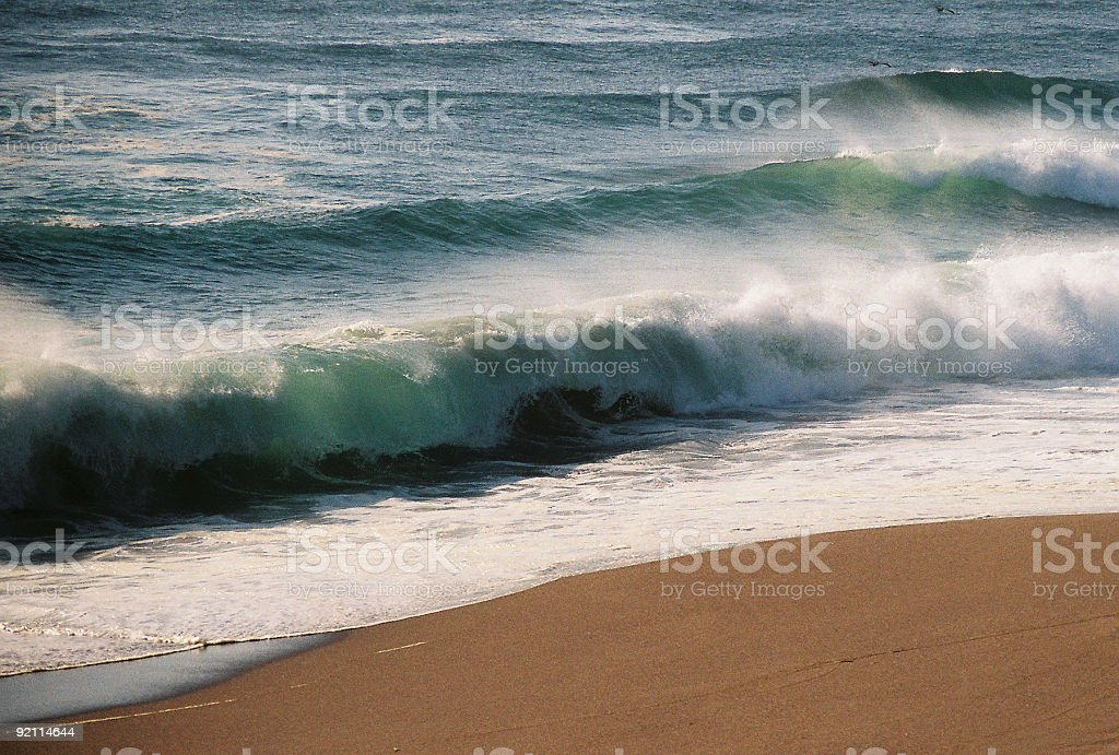 Hawaii beach and wave at sunset stock photo