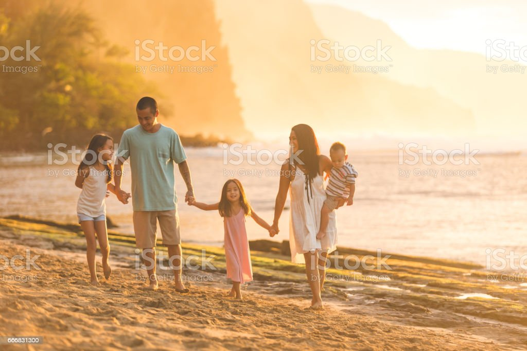 Hawaii family vacation on beach stock photo