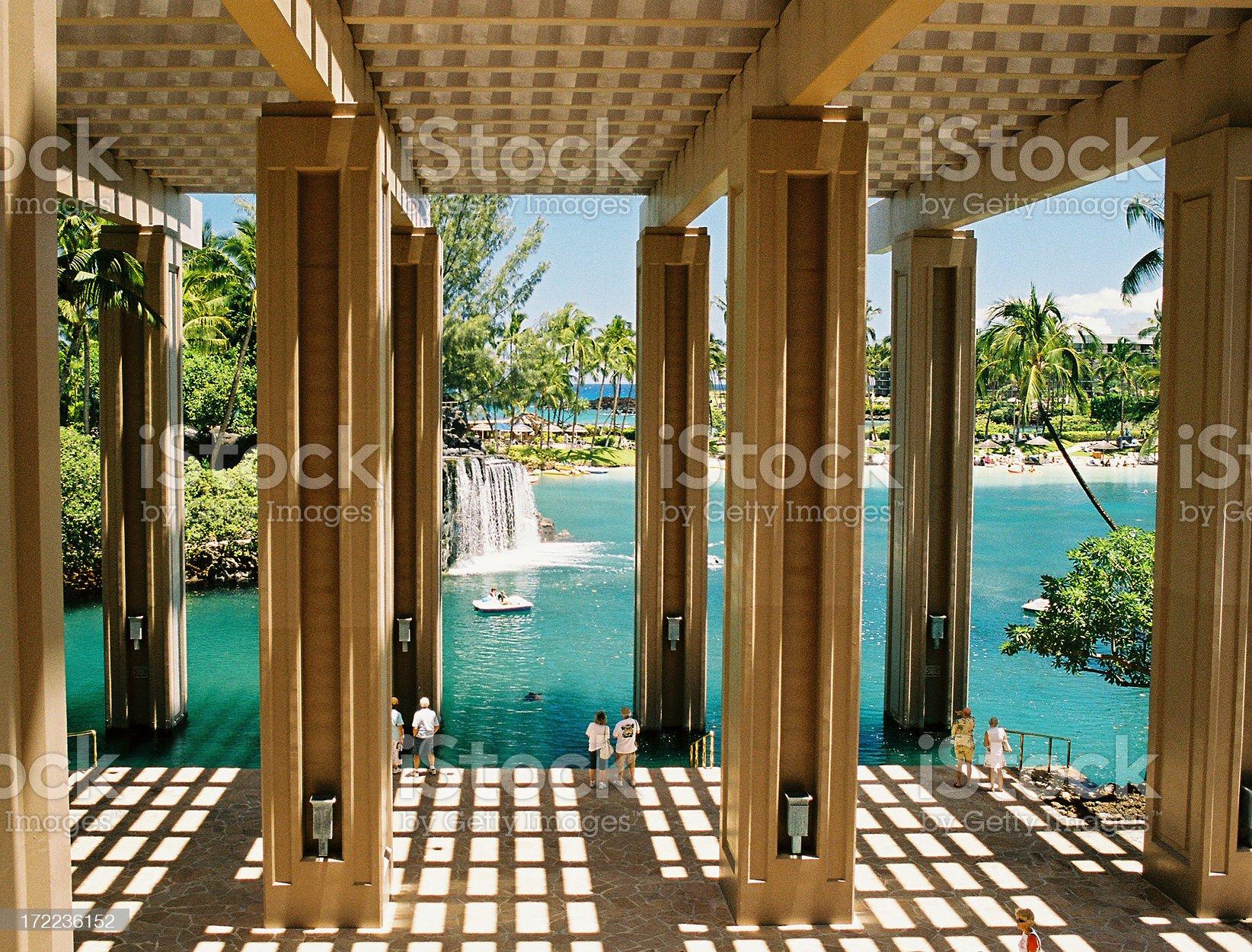 Hawaii hotel, tourists and waterfall royalty-free stock photo
