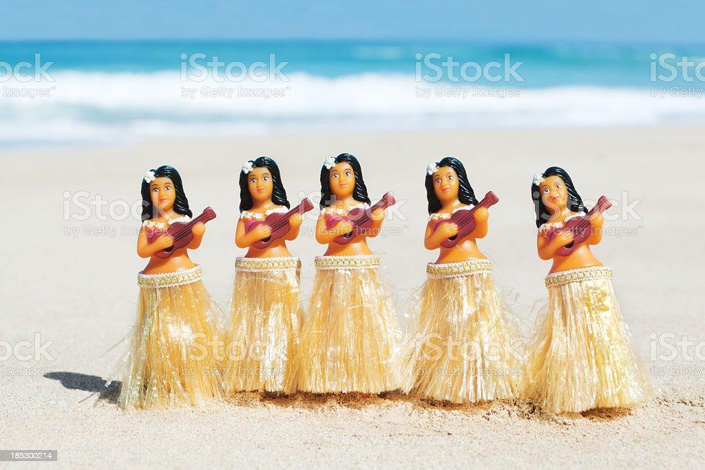 Hawaii Hula Dancers Figurine Dolls Dancing on Beach, Strumming Ukuleles stock photo