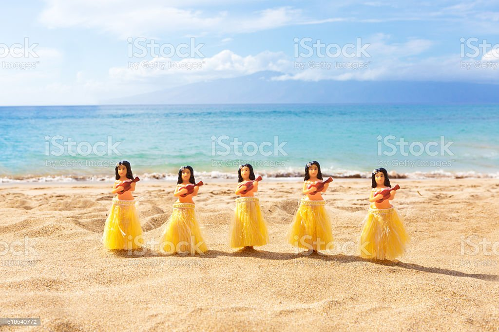 Hawaii Hula Dancers Figurine Dolls Dancing on Maui Kaanapali Beach stock photo